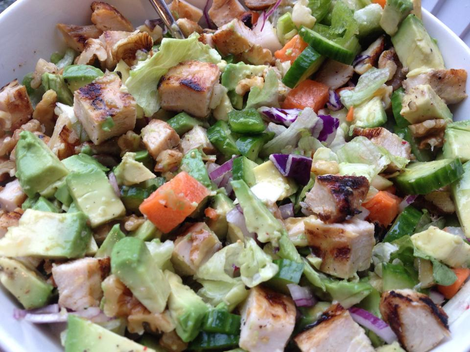 Big salad with grilled chicken, avocado and lots of veggies.